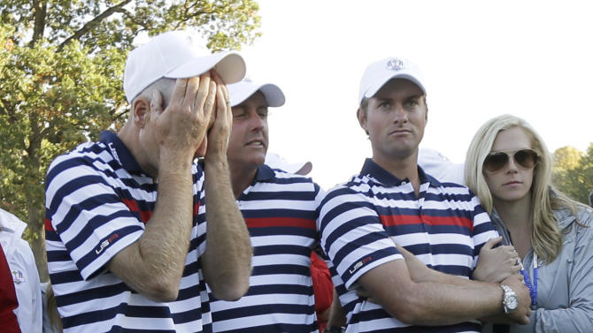 USA's Jim Furyk reacts as European players celebrate after winning the Ryder Cup PGA golf tournament Sunday, Sept. 30, 2012, at the Medinah Country Club in Medinah, Ill. Next to Furyk are Phil Mickelson and Webb Simpson. (AP Photo/David J. Phillip)