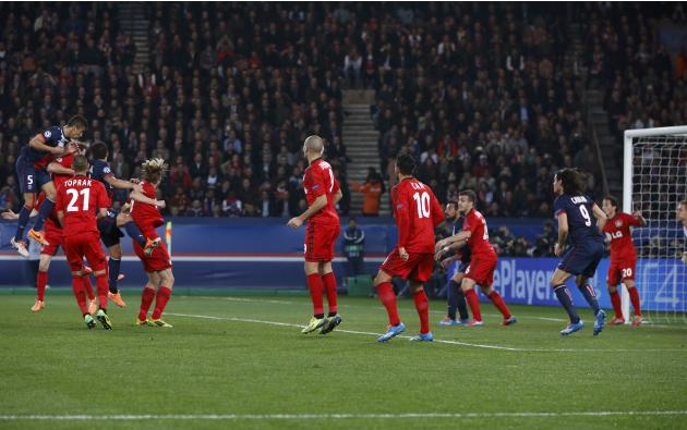 Paris St Germain's Marquinhos scores against Bayer Leverkusen during their Champions League round of 16 second leg soccer match at the Parc des Princes Stadium in Paris