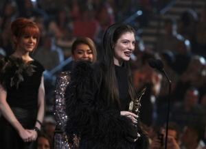 Singer Lorde accepts the top new artist award onstage at the 2014 Billboard Music Awards in Las Vegas