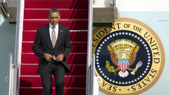 President Barack Obama walks down the stairs from Air Force One upon arrival at Andrews Air Force Base, Md., on Friday, March 29, 2013. ( AP Photo/Jose Luis Magana)