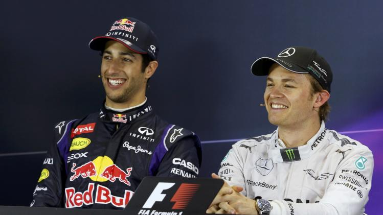 Winner Mercedes Formula One driver Rosberg of Germany and second-placed Red Bull Formula One driver Ricciardo of Australia speak at a news conference after the Australian F1 Grand Prix in Melbourne