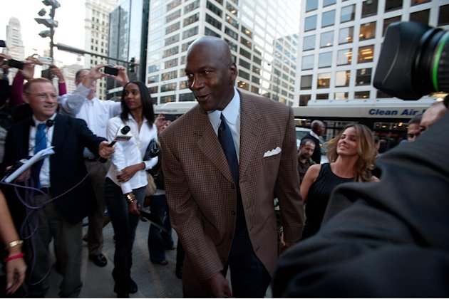 COMMERCIAL IMAGE - In this photograph taken by AP Images for Michael Jordan's Steak House, Michael Jordan and Yvette Prieto arrive at the Grand Opening Celebration of Michael Jordan's Steak House in C