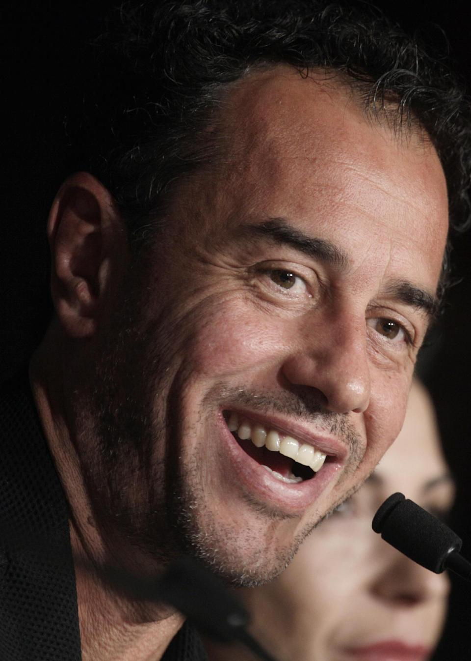 Director Matteo Garrone answers questions during a press conference for Reality at the 65th international film festival, in Cannes, southern France, Friday, May 18, 2012. (AP Photo/Virginia Mayo)