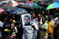 &lt;p&gt;A South African miner holds the portrait of a colleague who died during clashes with police on October 4. Representatives of 12,000 fired Anglo American Platinum workers in South Africa will lay murder charges after a colleague was killed in clashes with police, a leader has said.&lt;/p&gt;