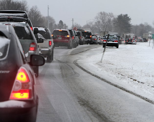 Cars are stuck in traffic as a winter storm arrives , Friday, Feb. 8, 2013 in Newington, N.H. Snow began to fall around the Northeast on Friday at the start of what's predicted to be a massive, possib