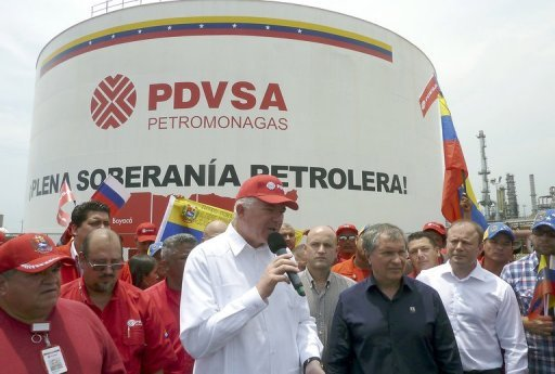 President of Venezuela's PDVSA, Rafael Ramirez (C) speaks next to Rosneft Executive Chairman Igor Sechin on May 23, 2013