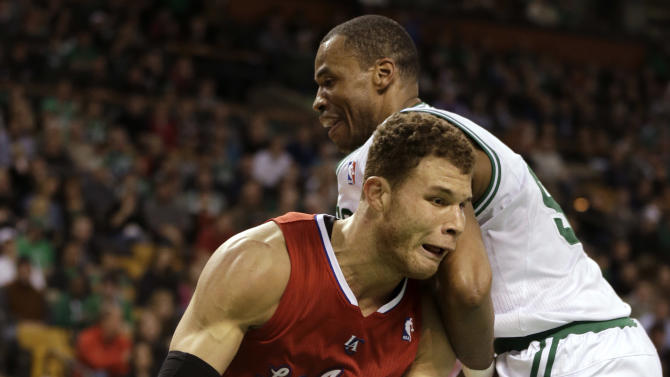 Los Angeles Clippers forward Blake Griffin, left, looks for an opening around Boston Celtics center Jason Collins, right, in the first quarter of an NBA basketball game at the TD Garden in Boston, Sunday, Feb. 3, 2013. (AP Photo/Steven Senne)
