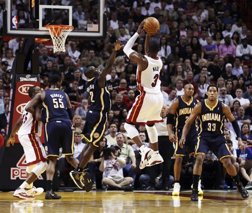 Wade beats buzzer, Heat top Pacers 93-91 in OT