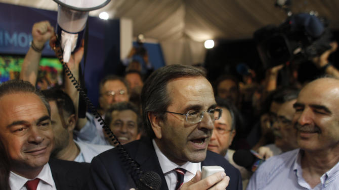 Leader of the New Democracy conservative party Antonis Samaras, speaks to supporters at an election kiosk  at Syntagma square in Athens, Sunday, June 17, 2012. The pro-bailout New Democracy party came in first Sunday in Greece's national election, and its leader has proposed forming a pro-euro coalition government.(AP Photo/Kostas Tsironis)