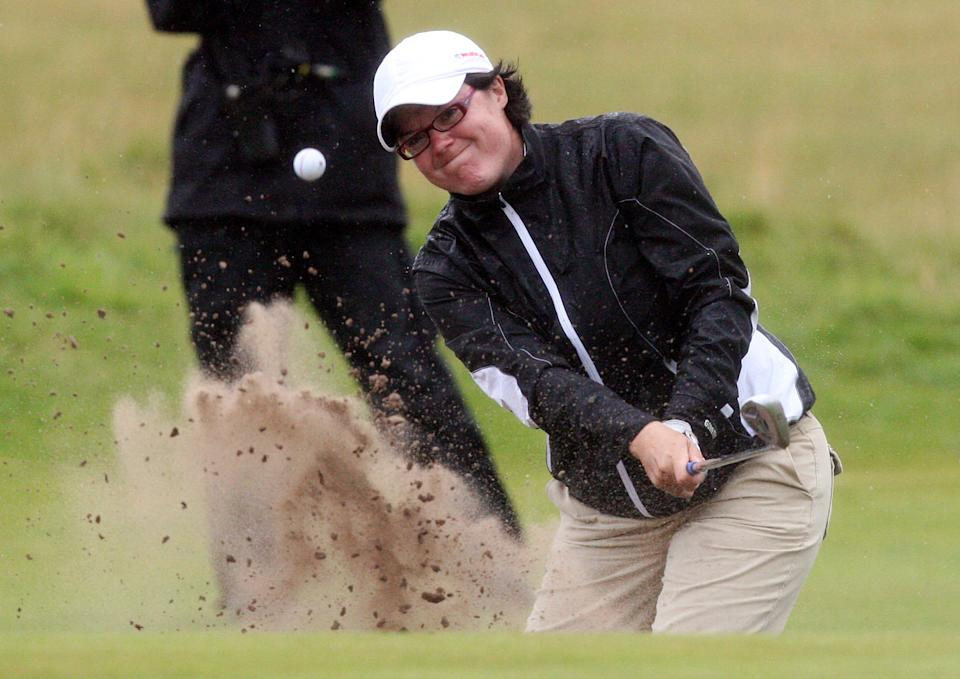 Wales' Becky Brewerton, plays her shot from the bunker at the eighteenth, during the first round of the Women's British Open at Carnoustie Golf Club, Carnoustie, Scotland, Thursday July 28, 2011.(AP Photo/Scott Heppell)