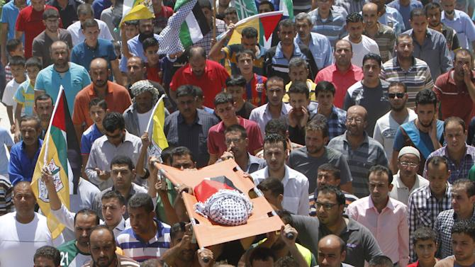 Mourners carry the body of 18-month-old Palestinian baby Ali Dawabsheh, who was killed after his family's house was set on fire in a suspected attack by Jewish extremists in Duma village near Nablus