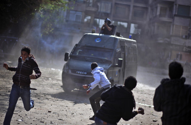 Egyptian protesters clash with security forces near Tahrir square, in Cairo, Egypt, Wednesday, Nov. 28, 2012. Egyptian state television says the country's highest appeal court has decided to suspend i