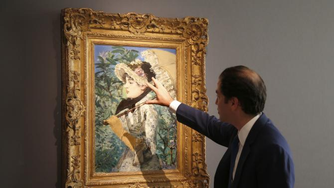 """Adrien Meyer, international director at Christie's, shows the painting """"Le Printemps"""", 1881, by French painter Edouard Manet during its presentation at Christie's Auction House in Paris"""