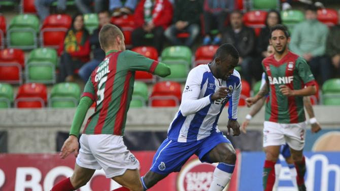 Porto's Martinez fights for the ball with Maritimo's Bauer during their Portuguese premier league soccer match at Barreiros stadium in Funchal