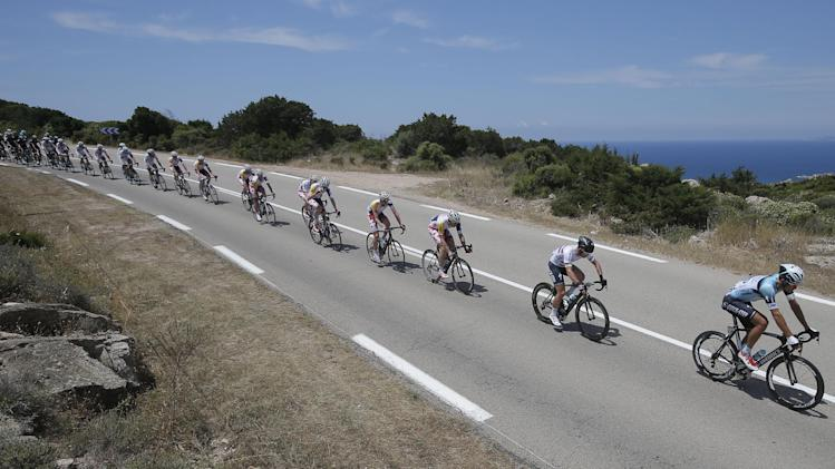 Britain's sprinter Mark Cavendish, second right, rides in the pack along the coast line of the Mediterranean Sea during the first stage of the 100th edition of the Tour de France cycling race over 213 kilometers (133 miles) with start in Porto Vecchio and finish in Bastia, Corsica island, France, Saturday June 29, 2013.(AP Photo/Laurent Cipriani)