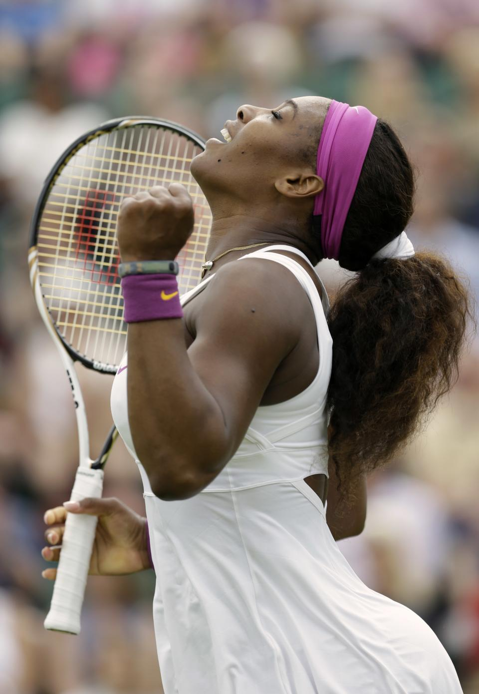 Serena Williams of the United States reacts during a first round women's singles match against Barbora Zahlavova Strycova of the Czech Republic at the All England Lawn Tennis Championships at Wimbledon, England, Tuesday, June 26, 2012. (AP Photo/Alastair Grant)