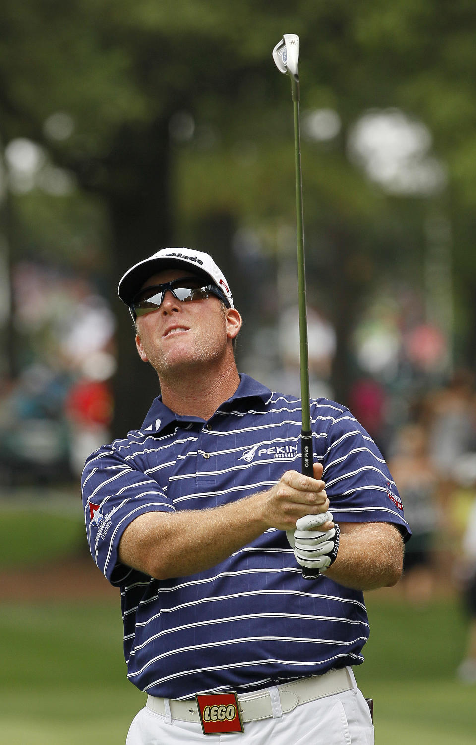 D.A. Points watches a shot from the first fairway during the third round of the Wells Fargo Championship golf tournament at Quail Hollow Club in Charlotte, N.C., Saturday, May 5, 2012. (AP Photo/Gerry Broome)