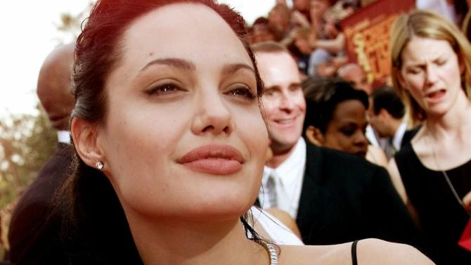 """FILE - In this March 12, 2000 file photo, Actress Angelina Jolie arrives at the 6h Annual Screen Actors Guild Awards in Los Angeles. Jolie won an award for Outstanding Performance for a Female Actor in a Supporting Role for """"Girl, Interrupted."""" Less than two weeks after Angelina Jolie had a double mastectomy to avoid breast cancer, her aunt has died from the disease. Jolie's aunt Debbie Martin died at age 61 Sunday in a San Diego-area hospital, her husband Ron Martin tells The Associated Press. Debbie Martin was the younger sister of Jolie's mother Marcheline Bertrand, whose own death from cancer in 2007 inspired the surgery that Jolie described in a May 14 New York Times op-ed. (AP Photo/Damian Dovarganes, File)"""