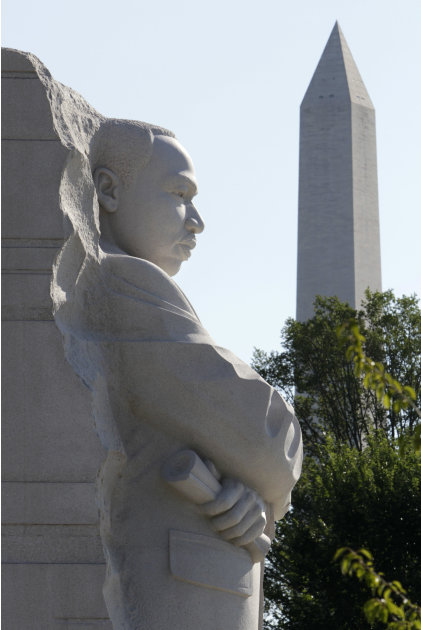 The statue of Dr. Martin Luther King, Jr. is seen unveiled from scaffolding during the soft opening of the Martin Luther King, Jr. Memorial in Washington, Monday, Aug. 22, 2011. The memorial will be d