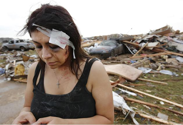 Cindy Wilson texts to friends Monday, May 20, 2013 after her home was destroyed by a massive tornado that ripped through Moore, Okla., in the afternoon. Wilson and her husband, Staff Sgt. B. Wilson, t