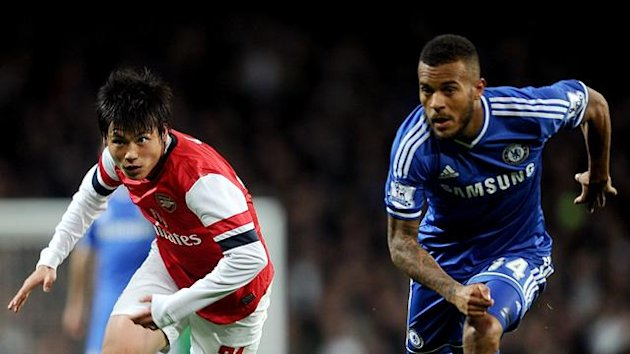 Arsenal's Ryo Miyaichi (left) and Chelsea's Ryan Bertrand battle for the ball (PA Photos)