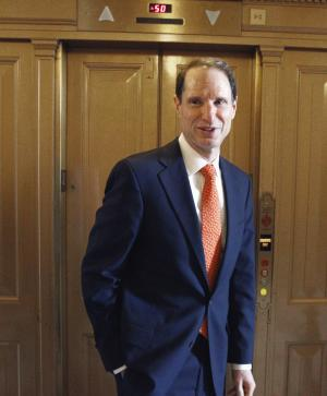 """FILE - In this Dec. 18, 2010 file photo, Sen. Ron Wyden, D-Ore., walks near the floor of the Senate on Capitol Hill in Washington. Nearly a year after the Obama administration announced an overhaul of ethics rules to deter the cozy relationship between offshore oil and gas companies and the agency that regulates them, documents obtained by The Associated Press show that ties between the industry and its regulator persist. """"Our sense is the revolving door is still swinging too widely,"""" said Wyden, in an interview with AP, after reviewing the recusals. (AP Photo/Alex Brandon, File)"""