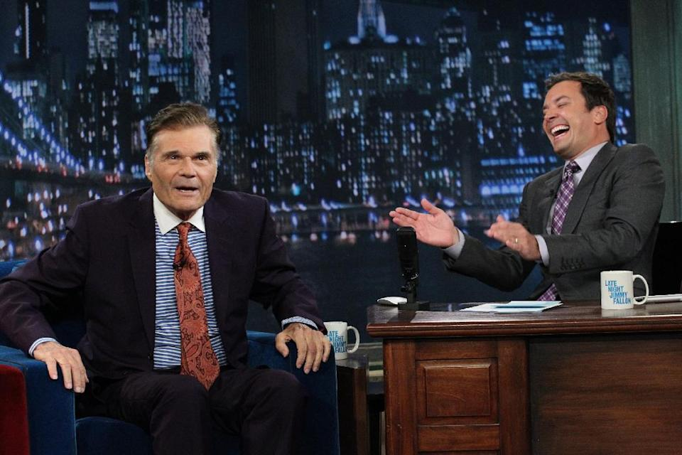 "In this photo taken Thursday, July 26, 2012 and provided by NBCUniversal, actor Fred Willard, left, joins host Jimmy Fallon on the set of Fallon's NBC show ""Late Night,"" in New York. (AP Photo/NBCUniversal, Lloyd Bishop)"
