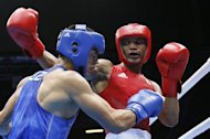 Uktamjon Rahmonov of Uzbekistan (in blue) defends against Roniel Iglesias Sotolongo of Cuba (in red) during the Light Welterweight boxing quarterfinals of the 2012 London Olympic Games at the ExCel Arena August 8, 2012 in London. Iglesias Sotolongo  advanced to the semi-finals with a 21-15 points decision.   AFP PHOTO / Jack GUEZ