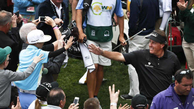 After the final round, Phil Mickelson, upper right, celebrates with the crowd after winning the Waste Management Phoenix Open golf tournament on Sunday, Feb. 3, 2013, in Scottsdale, Ariz.(AP Photo/Ross D. Franklin)