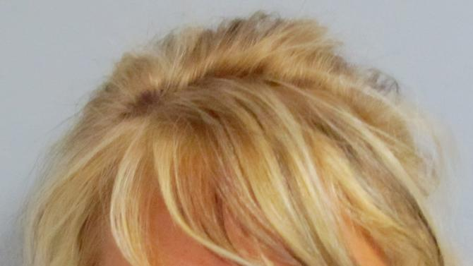 This photograph of Patricia Krentcil was released by the Essex County Prosecutor's Office, Wednesday, May 2, 2012 in Newark, N.J. Krentcil, of Nutley, N.J., whose own skin is deeply bronze-colored from regular visits to a tanning salon, has been accused of taking her 5-year-old daughter into a tanning booth in violation of state law. Krentcil entered a plea of not guilty Wednesday in Superior Court to a charge of child endangerment. (AP Photo/Essex County Prosecutor's Office)