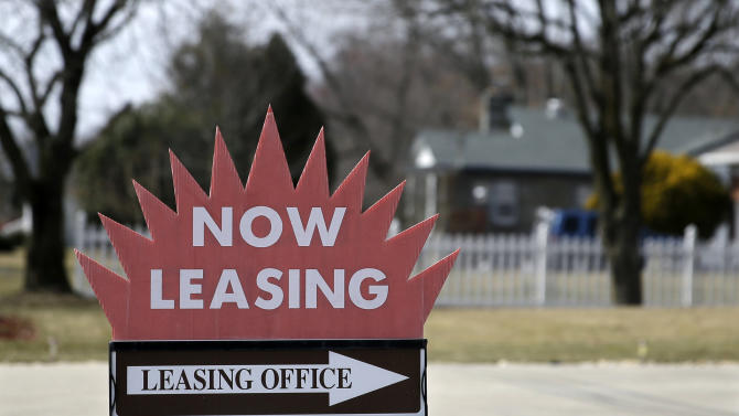 "This March 16, 2015 photo shows a ""now leasing"" sign outside an apartment complex near Millville, N.J. Real estate data firm Zillow releases its latest data on rental prices around the country on Thursday, July 29, 2015. (Photo/Mel Evans)"