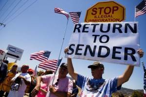 Demonstrators picket against the possible arrivals of undocumented migrants who may be processed at the Murrieta Border Patrol Station in California