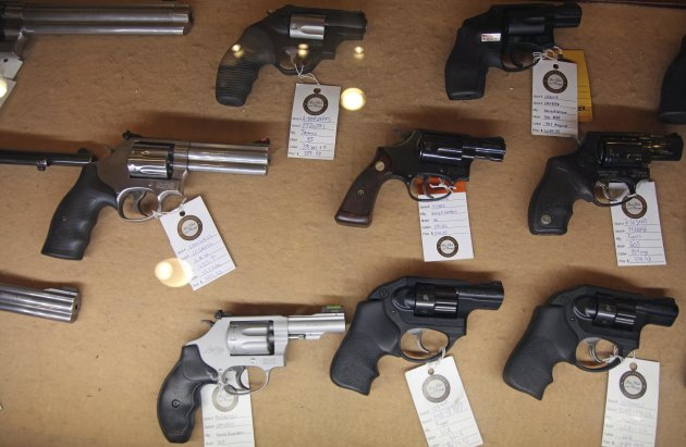 In this Jan. 4, 2013, photo, handguns are displayed in the sales area of Sandy Springs Gun Club and Range, in Sandy Springs, Ga. (Robert Ray/AP)