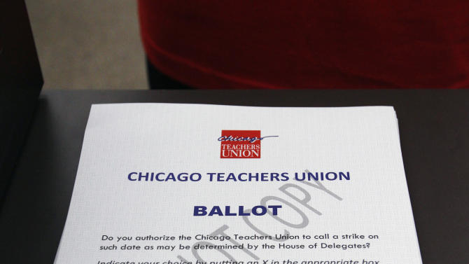 Ballots are stacked at a Chicago high school Wednesday, June 6, 2012, as voting began in the Chicago Teacher Union's strike authorization vote. Chicago Teachers Union President Karen Lewis says union members don't want to disrupt the start of the next school year with a strike, but she says they feel voting to authorize one is needed to negotiate a better contract. (AP Photo/M. Spencer Green)