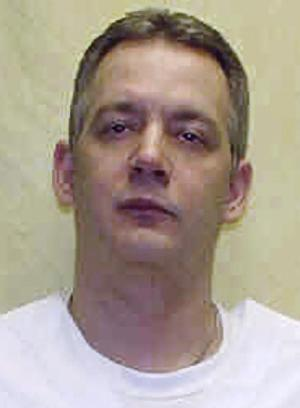 """FILE - This undated file photo provided by the Ohio Department of Rehabilitation and Corrections shows death row inmate Brett Hartman. Hartman was executed Tuesday, Nov. 13, 2012 at the Southern Ohio Correctional Facility in Lucasville, Ohio for the 1997 death of Winda Snipes.  Warden Donald Morgan said the time of death was 10:34 am. The Ohio Parole Board has unanimously denied Hartman's requests for clemency three times, citing the brutality of the Snipes' slaying and the """"overwhelming evidence"""" of Hartman's guilt.  (AP Photo/Ohio Department of Rehabilitation and Corrections, File)"""