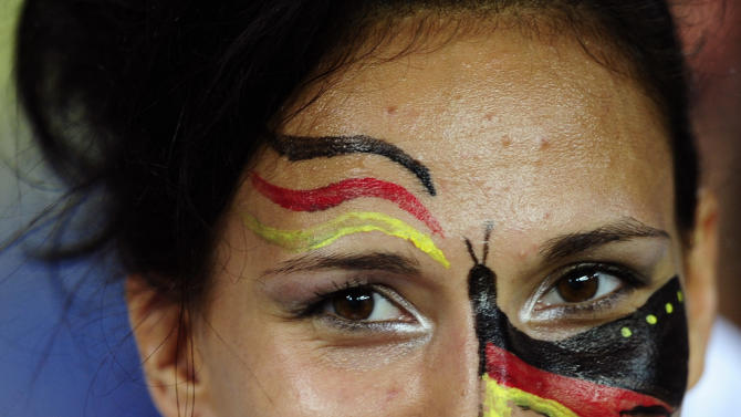 A Germany fan smiles prior to the the Euro 2012 soccer championship Group B match between the Netherlands and Germany in Kharkiv, Ukraine, Wednesday, June 13, 2012. (AP Photo/Manu Fernandez)