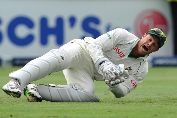 JOHANNESBURG, SOUTH AFRICA - JANUARY 14:   Mark Boucher of South Africa takes the catch to get the wicket of Graeme Swann of England for 27 runs during day one of the fourth test match between South A