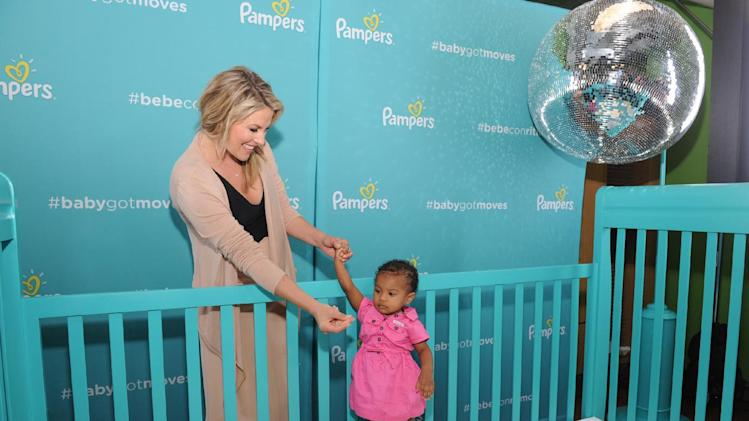 "Expectant actress Ali Larter and a little guest ""rock out"" at the Pampers #BabyGotMoves event at the Children's Museum of Manhattan, Wednesday, Aug. 20, 2014, in New York. Parents can post videos of their little ones' best morning moves using #babygotmoves or #bebeconritmo and it may be featured in a Pampers video. (Photo by Diane Bondareff/Invision for Pampers/AP Images)"