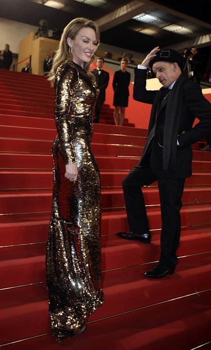 Actor Denis Lavant, right, and Kylie Minogue pose as they arrive for the screening of Holy Motors at the 65th international film festival, in Cannes, southern France, Wednesday, May 23, 2012. (AP Phot