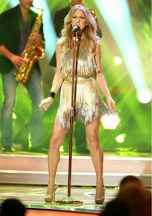 "Later that same evening, Celine hit the stage for an inspired performance of the Ike & Tina Turner classic, ""River Deep - Mountain High,"" in a gold fringed Versace halterneck dress and strappy, nude-h"