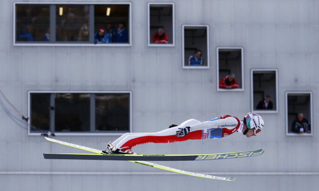 Switzerland's Ammann soars past the judges tower during the second jumping of the 61st four-hills ski jumping tournament in Garmisch-Partenkirchen