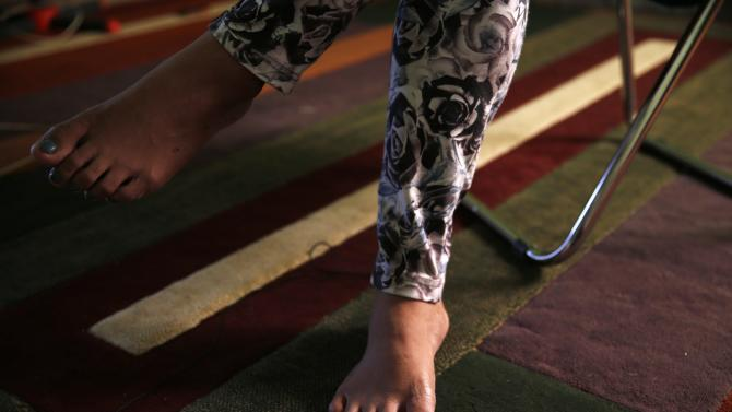 The painted toenails of a transgender person are seen during an interview at her office in Banda Aceh