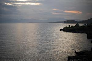 A man fishes on the edge of Lake Kivu on May 28, 2012 …