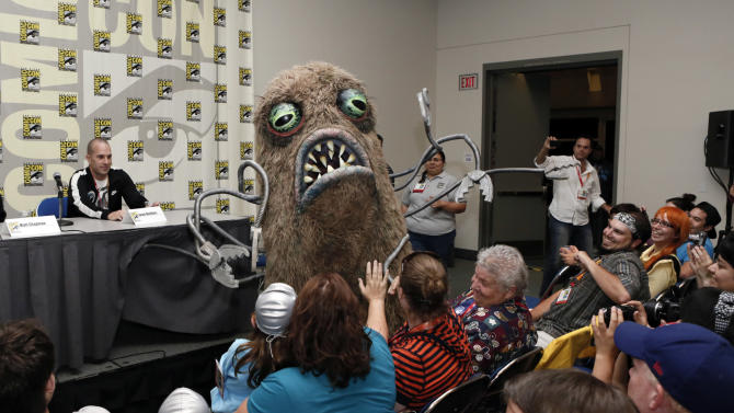 """COMMERCIAL IMAGE - The Hairy Tentacle Monster surprises fans during """"The Aquabats! Super Show!"""" panel at Comic-Con on Friday, July 13, 2012, in San Diego, Calif. (Photo by Todd Williamson/Invision for The Hub/AP Images)"""