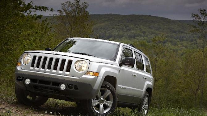 FILE - This undated file product image provided by the Chrysler Group, shows the 2011 Jeep Patriot. U.S. government safety regulators are investigating complaints that engines on Jeep Patriot SUVs can stall without warning at highway speeds. The National Highway Traffic Safety Administration (NHTSA) said Friday, Oct. 19, 2012 that it received a dozen complaints about stalling. The investigation affects about 112,000 Patriots from the 2011 and 2012 model years that were sold in the U.S. Chrysler Group LLC, the maker of Jeeps, sold another 18,000 in Canada.   (AP Photo/Chrysler Group, File) NO SALES