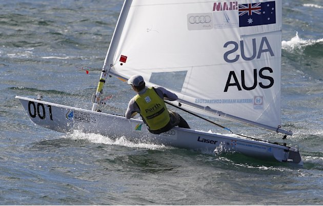 Australia's Tom Slingsby sails on his way to win the men's Laser gold medal race at the World Sailing Championships in Perth, Australia, Sunday, Dec. 18, 2011. (AP Photo/ Theron Kirkman)