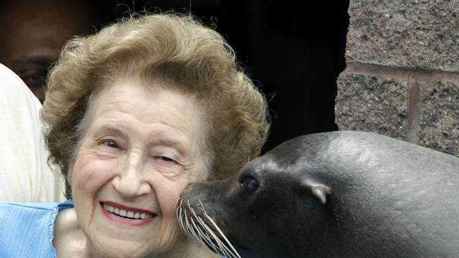 FILE - In this Aug. 8, 2011 file photo, former Pittsburgh Mayor Sophie Masloff is kissed by Maggie, a sea lion at the Ptitsburgh Zoo & Aquarium, in Pittsburgh. Masloff, who rose from a tax clerk to become Pittsburgh's first female mayor, died Sunday, Aug. 17, 2014. She was 96. (AP Photo/Gene J. Puskar, File)