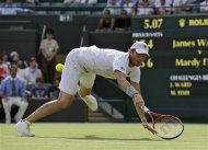 Mardy Fish of the United States dives for a shot against James Ward of Britain during a second round men's singles match at the All England Lawn Tennis Championships at Wimbledon, England, Thursday, June 28, 2012. (AP Photo/Sang Tan)