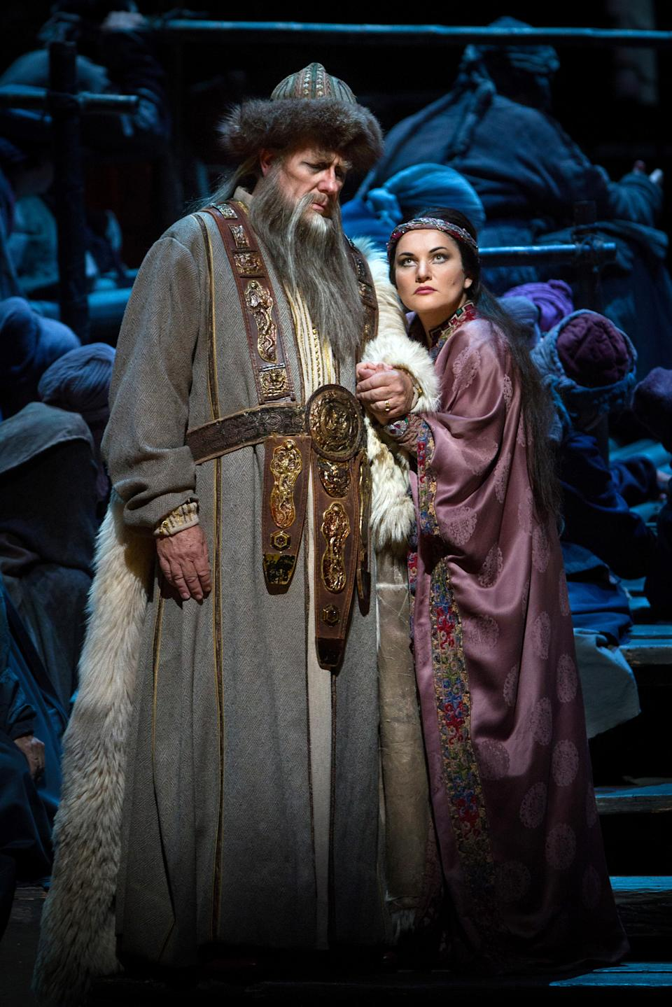 "This Sept. 13, 2012, photo provided by the Metropolitan Opera shows James Morris as Timur with Hilba Gerzmava as Liu a scene from Puccini's ""Turandot,""  during a dress rehearsal at the Metropolitan Opera in New York. (AP Photo/Metropolitan Opera, Marty Sohl)"
