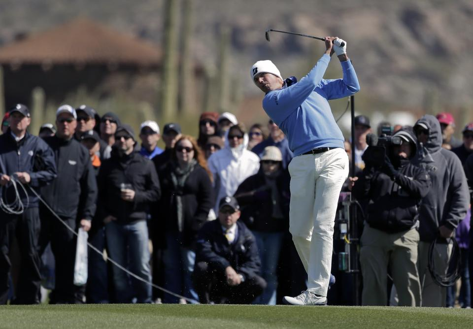 Matt Kuchar hits a shot off the first fairway in the final round of play against Hunter Mahan during the Match Play Championship golf tournament, Sunday, Feb. 24, 2013, in Marana, Ariz. (AP Photo/Julie Jacobson)